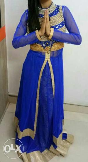 This is a blue gown dress. Fully design on neck
