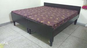 2 single beds with mattresses