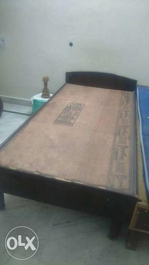 2 single wooden beds in good condition.