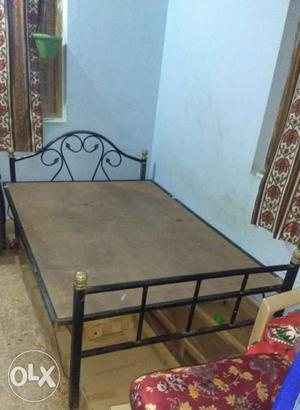 Queen size iron cot in good condition. Less than