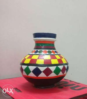 Beautiful earthern pot hand painted in block