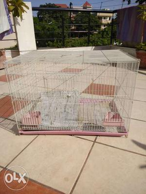 Pets cage 23 inch by 16 inch by 16 I with two