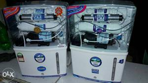 Two White-and-blue Water Purifiers