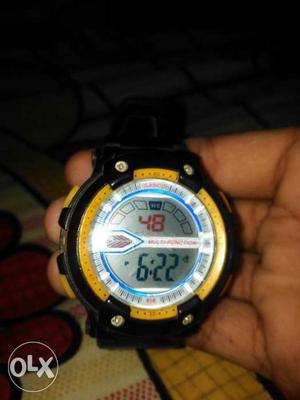A digital watch at price 50 at jaitpur new delhi
