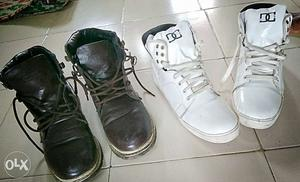 Two Pairs Of White And Black Shoes