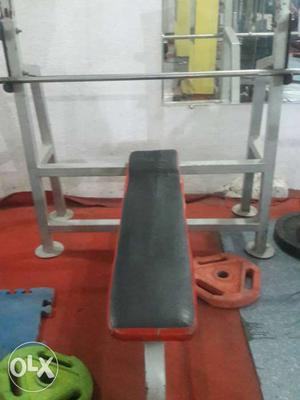 Black And Gray Weight Bench With Barbell