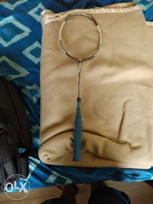 Brown And Blue Badminton Racket