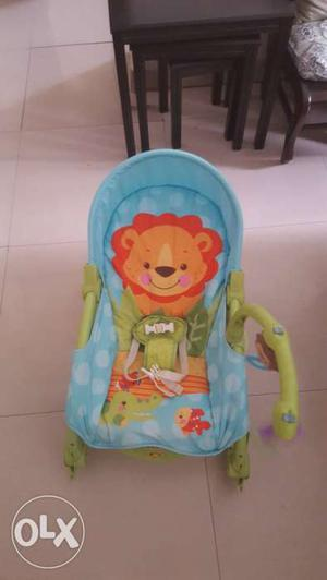 Fisher price baby chair and walker.