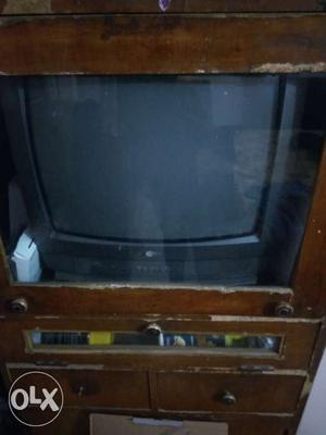 LG TV with wooden TV stand