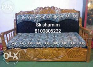 Brown Wooden Daybed With Gray And Blue Floral Mattress