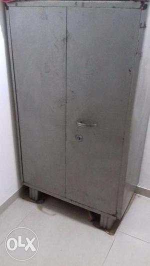 Want to sell 1 metal cupboard and 2 single wooden wadroab