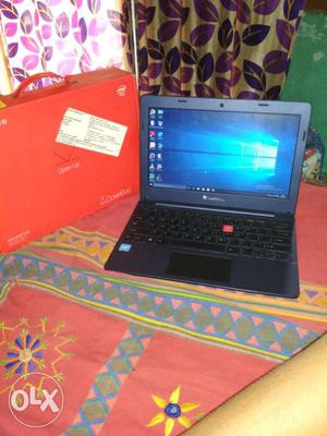 Blue Laptop Computer With Box