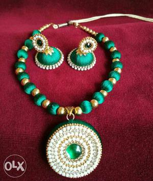 Silk thread necklace with ear rings.