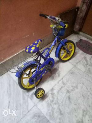 Toddler's Blue And Yellow Bicycle With Training Wheels