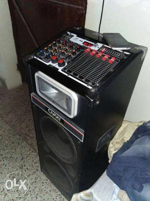 Black And Gray Audio Mixer And Black PA Speaker