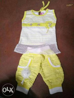 Toddler's White And Yellow Sleeveless Dress And Yellow Pants