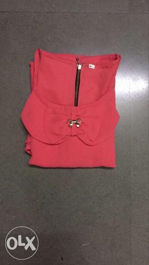 Peach colour synthetic top size L -XL
