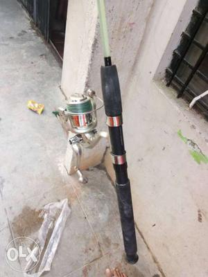 Black Fishing Rod With Silver Spinning Fishing Reel