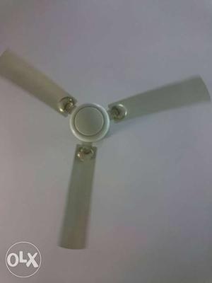 White colour bajaj fan is for sale. All in good