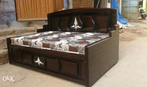 Brown Wooden Bed With White And Brown Floral Mattress
