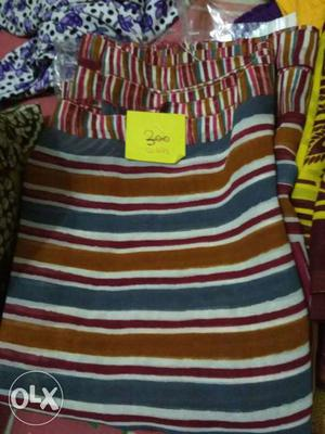 Blue, Red, And White Striped Textile