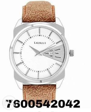 Branded new wrist watch with day & date,i want