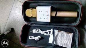 White And Gold-colored Wireless Microphone