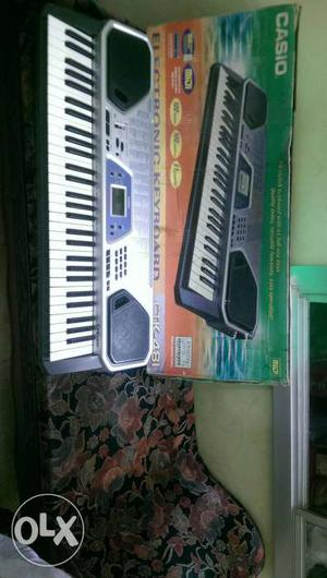 Black And Grey Electronic casio keyboard.