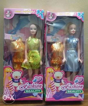 Good quality doll + 1 set dress+comb for sale.