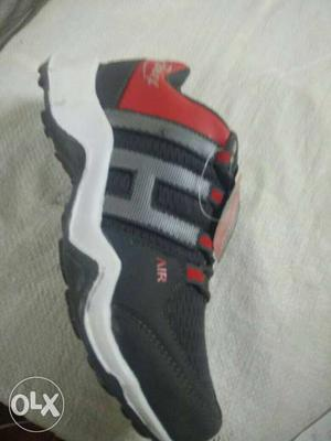 Black And Red Athletic Shoe
