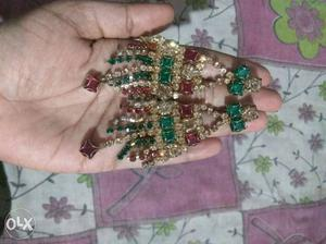 Gold plated red and green stones set with ear rings and