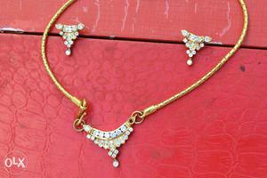 Set of Pendant and Earrings - Gold and American diamond
