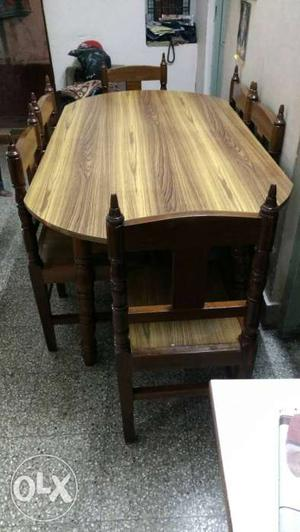 Pure teak wood antique dining table set with 6 chairs.