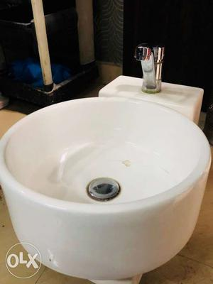 Round White Ceramic Sink With Grey Stainless Steel Faucet