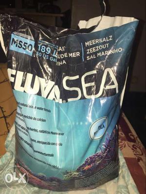 Marine fish tank fluval marine salt and marine flake food