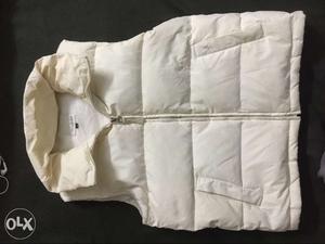 White Zip-up Bubble Vest. Imported.