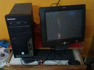 Black CRT Computer Monitor With Black Lenovo Computer Tower,