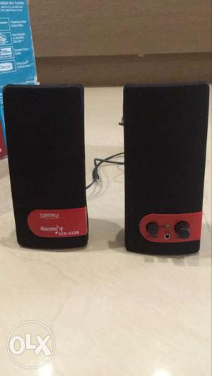 Two Black And Red Computer Speakers