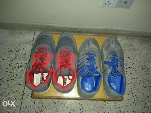 2 pair of brand new unused sports shoes- size 9 both