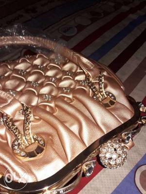 Branded purse with diamonds stones. only serious