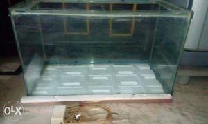 Aquarium & wood shade with stones n filter.