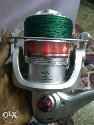Grey And Red Fishing Reel