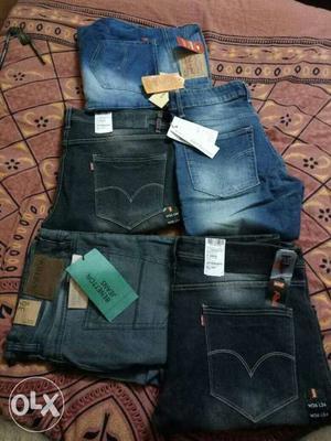 Blue Denim Jeans And Black Denim Shorts
