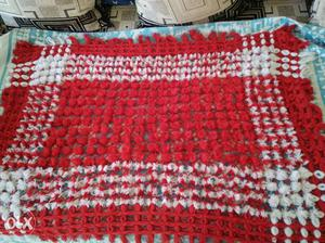 Red And White Knitted Textile