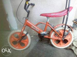 Red And White Bicycle With Training Wheels
