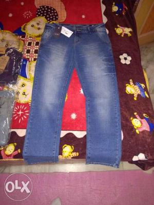 Blue Denim Jeans And Red And White Floral Textile
