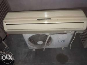 White LG Split-type Air Conditioner With LG Air Condenser