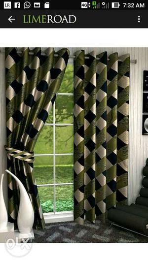 Green, White, And Black Window Curtain Screenshot