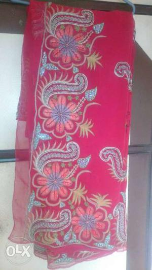 Beautiful bright pink saree with whole work.