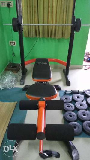 Black And Orange Weight Bench With Adjustable Legs Press and